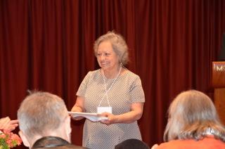 Cecilia accepting her award
